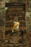Ruin buddha statue of wat Suwandawas. Ayutthaya. The ancient abandoned ruin statue of Buddha locate in middle of the city of Ayutthaya. This collapse temple is Royalty Free Stock Photography