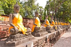 Ruin Buddha statues in row Stock Image