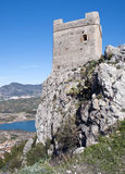 Ruin of castle. Lake located in the town of Zahara de la Sierra in the Spanish province of Cadiz, is the coast and mountain scenery in the background, image Stock Photos