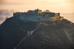 Ruin of a Castle on a Hill. Ruin of the Castle on the Hill at Sunrise. Schlossberg Castle in Hainburg an der Donau, Austria at Sunrise as Seen from Hundsheimer royalty free stock images