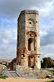 Ruin of castle tower, Poland. Old, ruined stone clock tower of Krzyztopor castle in Ujazd, Poland royalty free stock image