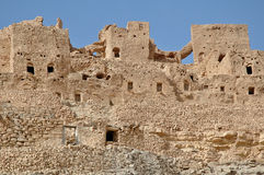 Ruin in Chenini (Tunisia). The Dahar plateau is the westernmost tip of the Atlas range. Perched on mountain-tops, the villagers have built their homes literally Stock Image