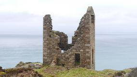 Ruin of a Cornish Tin Mine. The ruin of a 19th century tin mine standing on the cliffs overlooking the Atlantic Ocean in Cornwall UK Stock Images