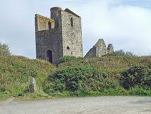 Ruin of a Cornish tin mine wheelhouse. A ruin of a Cornish tin mine wheelhouse near St Ives Cornwall Stock Photo