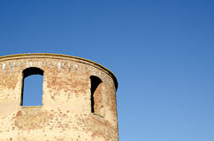 Ruin detail. Detail from a tower of an old castle ruin and a clear blue sky Royalty Free Stock Images