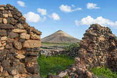 Ruin on Fuerteventura. Landscape - Central Fuerteventura - La Oliva - hill - blue sky - vegetation - ruin (house Stock Photography