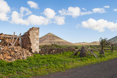 Ruin on Fuerteventura. Landscape - Central Fuerteventura - La Oliva - hills - blue sky - vegetation - ruin (house Royalty Free Stock Images