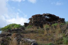 Ruin on a hill. Morbid house fallen into ruin on a hill under the blue sky Royalty Free Stock Photography