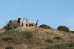 A ruin in the hills of the Tuscany landscape. A ruin stands out in the hills of the Tuscany landscape Royalty Free Stock Images
