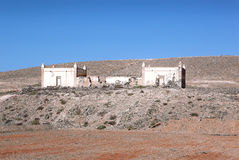 Ruin of a house in Fuerteventura. Ruin of a one-storied house with interesting pointed pillars near Ajui in Fuerteventura, Canary Islands, Spain Royalty Free Stock Photos