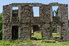 Ruin of a house. The ruin of a house surrounded by nature Stock Photos