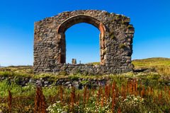 Ruin of Llanddwyn chapel, Anglesey. Arch of ruined chapel or church on Llanddwyn Island, a peninsula on Anglesey. Newborough, Anglesey, Wales, United Kingdom Stock Image
