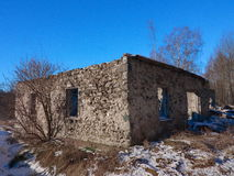 Ruin. Of an old barn in winter landscape Royalty Free Stock Photos