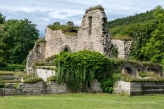 Ruin of an old cloister surrounded by a lush green environment royalty free stock images