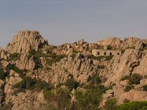 Old house on the granite. Ruin of an old house in the middle of the granite stock photos