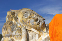 Ruin Old Reclining Buddha Image in Blue Clear Sky Stock Photography