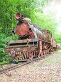 Ruin old train on the railway. In the forest Royalty Free Stock Image