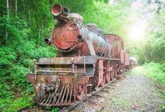Ruin old train on the railway. In the forest Stock Images