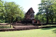 The ruin pagoda of Prang Song Phi Nong in archaeological site of Srithep ancient town in Petchaboon, Thailand. The influence of ancient Draravati and Khmer stock photo