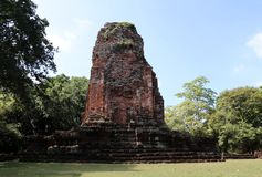 The ruin pagoda of Prang Srithep in archaeological site of Srithep ancient town in Petchaboon, Thailand. The influence of ancient Draravati and Khmer culture Stock Image