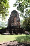 The ruin pagoda of Prang Srithep and foreground green tree in archaeological site of Srithep ancient town in Petchaboon, Thailand. The influence of ancient Royalty Free Stock Images
