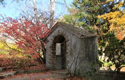 Ruin in the Park. Gate`s ruin in the autumn park Stock Photo