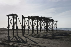 Ruin of the pier. Ruins of Pier Llico, Chile. Built Balmaceda government wrought iron where the main sail of grain shipments to America in the time of the gold Royalty Free Stock Photography