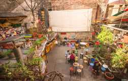 Ruin pubs of Budapest city. Budapest, Hungary - Mars 31, 2016: Outdoor terrace of one of the most attractive and touristic ruin pubs, the Szimpla, at Kazinczy Royalty Free Stock Image