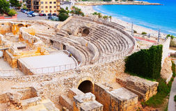 Ruin of Roman amphitheater at Mediterranean Royalty Free Stock Images