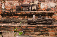 Ruin stone buddha. Ayutthaya is the ancient town in thailand. the old capital city Stock Photo