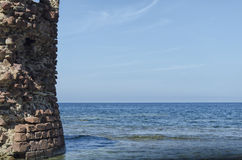 Ruin of tower emerges from sea Stock Photography