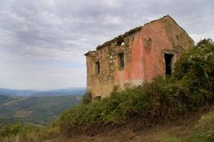 Ruin with a view. Old Italian ruin overlooking olive fields Stock Images