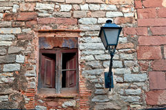 Ruin wall with antique lantern, Collbato, Spain Stock Images
