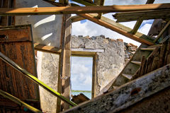 A ruin of what once was a house. The remains of a collapsed house in Scotland on the Island of Uist Stock Photo