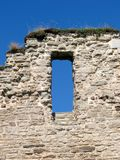 Ruin Window. A wall from a monastery ruin with a window and clear blue sky. Alvastra Sweden Royalty Free Stock Photos