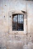 Ruin window with iron bars Stock Photo