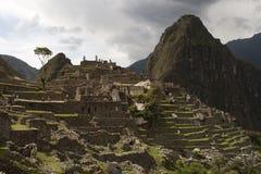 Ruinas de Machu Picchu y gimoteo Picchu Imágenes de archivo libres de regalías
