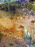 The ruined ancient entrance to the medieval town of Sovana, Italy. The hidden ancient ruins of the old wall of the ancient medieval town of Sovana in Tuscany Royalty Free Stock Photos