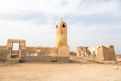 Abandoned mosque with minaret. Al Jumail. Middle east traditional town ruins, Qatar. stock photo