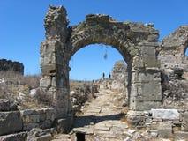 Ruined arch in Aspendos Stock Image
