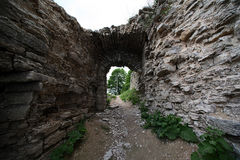 Ruined arch in the medieval fortress. Ancient ruined arch in the medieval fortress Stock Image