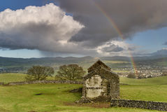 Ruined barn with rainbow Royalty Free Stock Photo