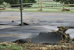 Ruined blacktop. After a flooding storm, a raised, bubbled and cracked blacktopped parking lot Royalty Free Stock Photos