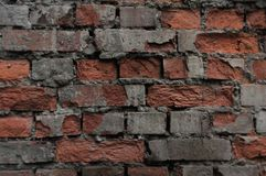 Ruined red brick wall stock photo