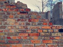 Ruined brick wall. In an abandoned place Stock Photos
