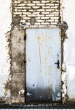 Ruined brick wall closed steel door Royalty Free Stock Photography