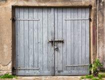 Ruined brick wall closed steel door Stock Images