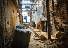 Ruined brick wall. Of old factory spaces inside Royalty Free Stock Photography