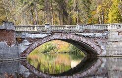 Ruined bridge over the river. Big obsolete bridge over the river Stock Photo