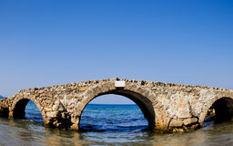 Ruined bridge in the sea. Zakynthos. Greece Stock Photography